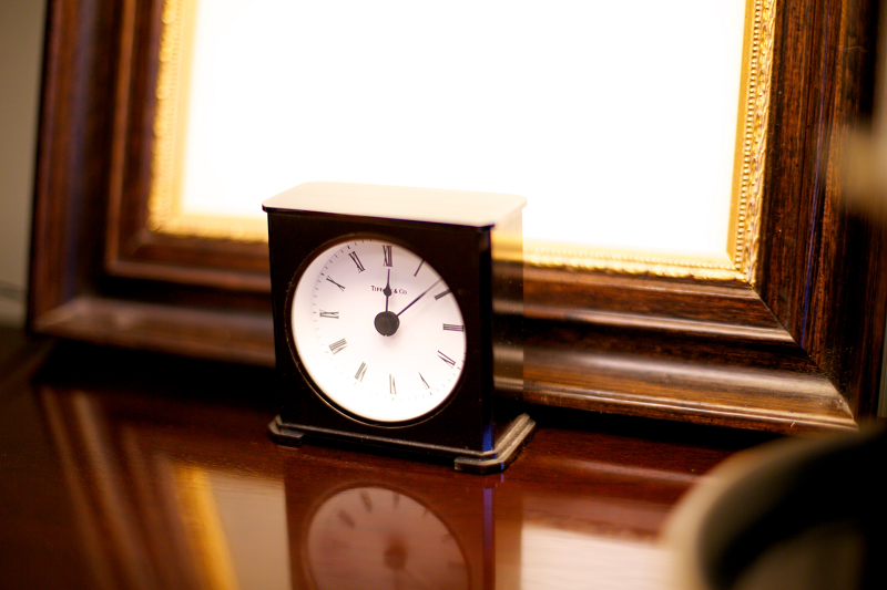 image of clock on a desk in front of a frame - Vetrano Vetrano and Feinman LLC